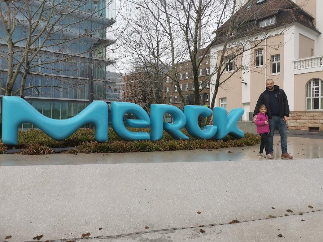 Daniel and his daughter at Merck