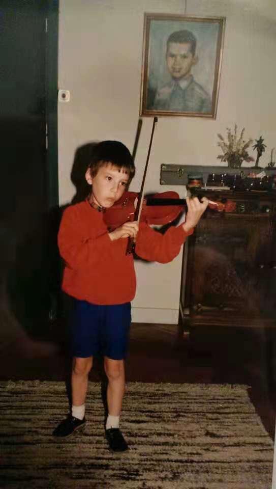 Patrick practises violin at an early age