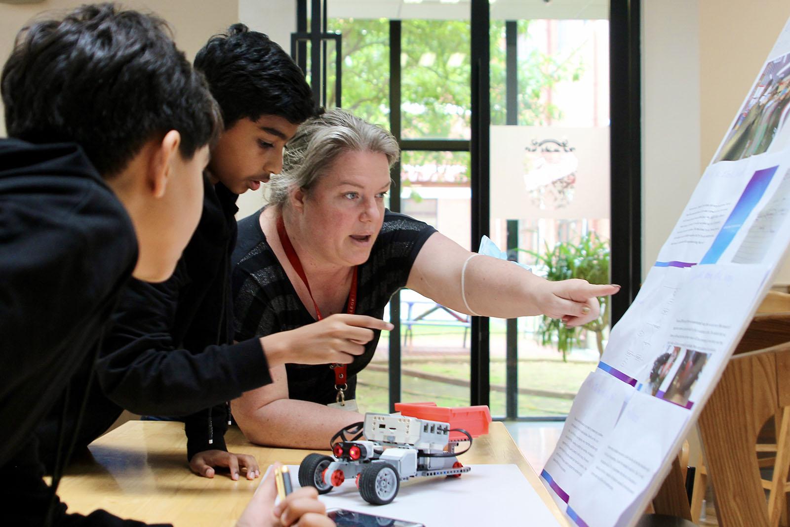 Head of Senior School Alison Derbyshire reviews a HakD presentation