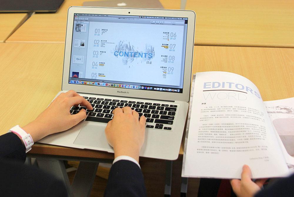 Student editing De Xin Magazine